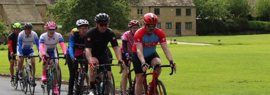 Cyclists cycling through The Cotswolds