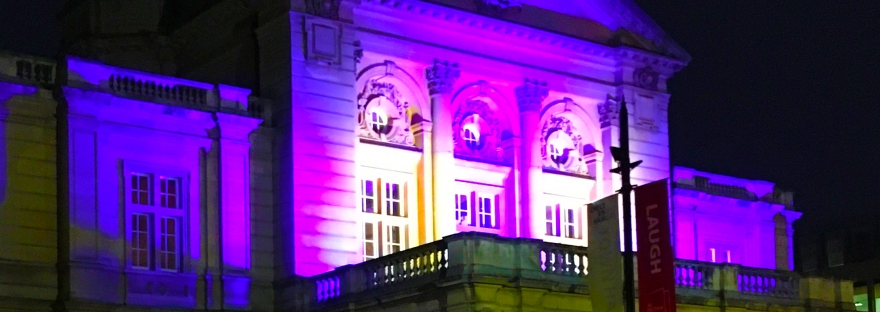 Cheltenham Town Hall lit up in purple light during Light Up Cheltenham