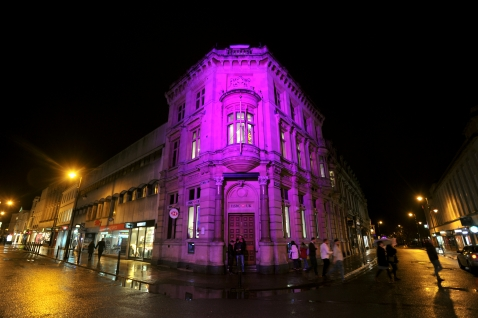 HSBC lit up in purple light during Light Up Cheltenham