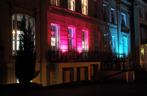 Knight Frank and Cotswold Transport Planning buildings lit up in blue and pink lights